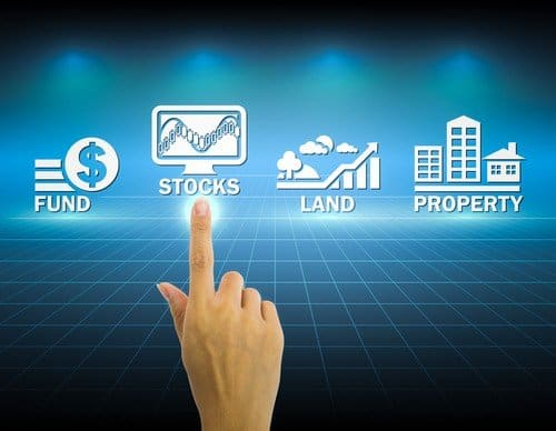 An Investment Conundrum – Choosing Between Stocks And Real Estate for NRIs